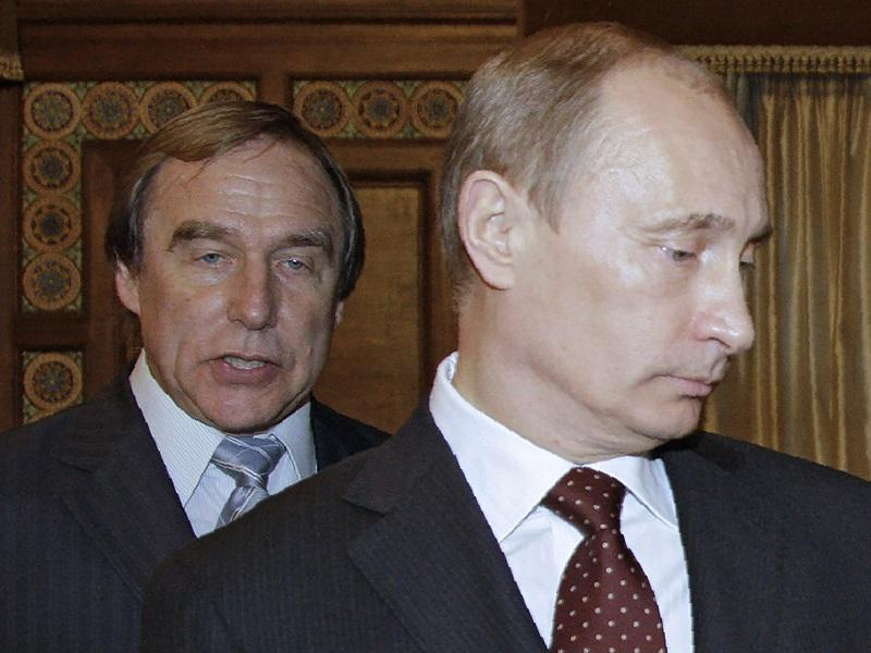 A photo taken 11/21/09 shows Russia's Prime Minister Vladimir Putin (front) and cellist Sergei Roldugin. The 'Panama Papers' leak puts him at the top of an offshore empire worth more than $2 billion.