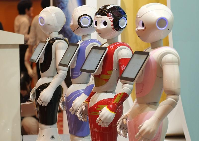 Japan's telecom giant Softbank's 'Pepper' humanoid robots are displayed at a hotel in Tokyo on July 20, 2016, ahead of the exhibition Pepper World 2016 Summer starting on July 21.