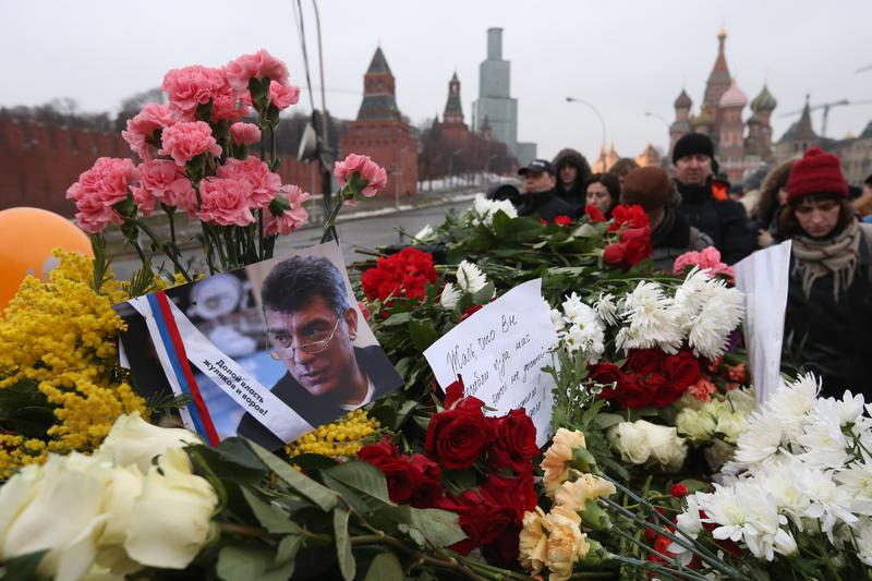 Mourners gather to place tributes at the site where Russian opposition leader and former Deputy Prime Minister Boris Nemtsov was killed on Bolshoi Moskvoretsky bridge near St. Basil cathedral.