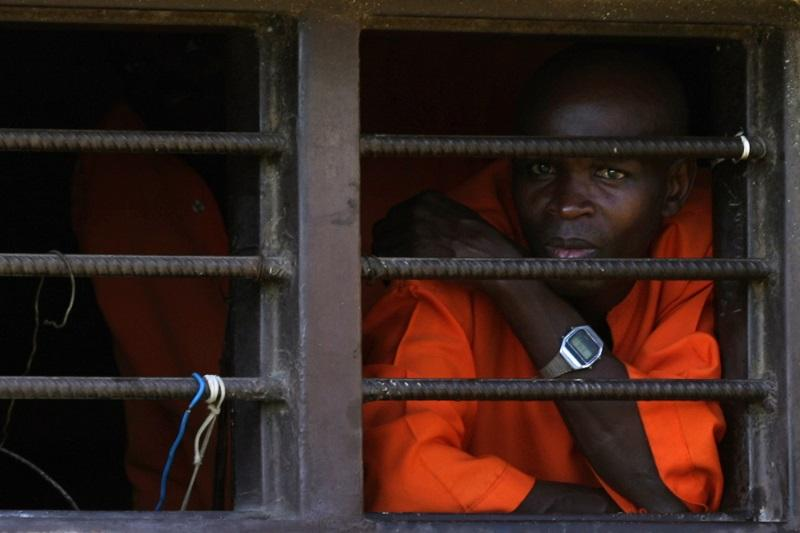 A prisoner looks out a window in the Golf Wing of the Nyanza Prison, where men convicted of genocide are housed April 3, 2014 in Nyanza, Rwanda.