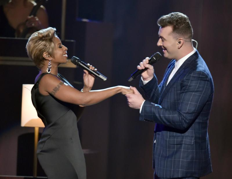 """Sam Smith, who took home four trophies including Record Of The Year, performs """"Stay With Me"""" with Mary J. Blige at the 57th annual Grammy Awards on Feb. 8, 2015."""