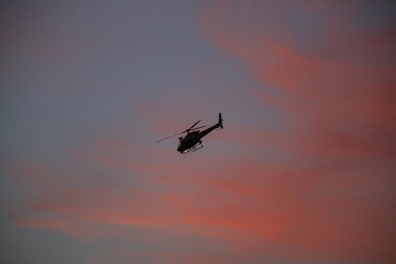 A police helicopter circled as officers searched for suspects following a shootout on December 2, 2015 in San Bernardino, California.
