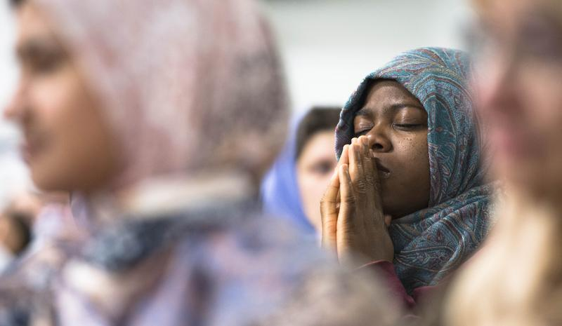 Local Muslim residents attend a gathering to mourn victims who were killed in the recent deadly shooting incident in Islamic Community Center in Loma Linda, San Bernardino, California, U.S.
