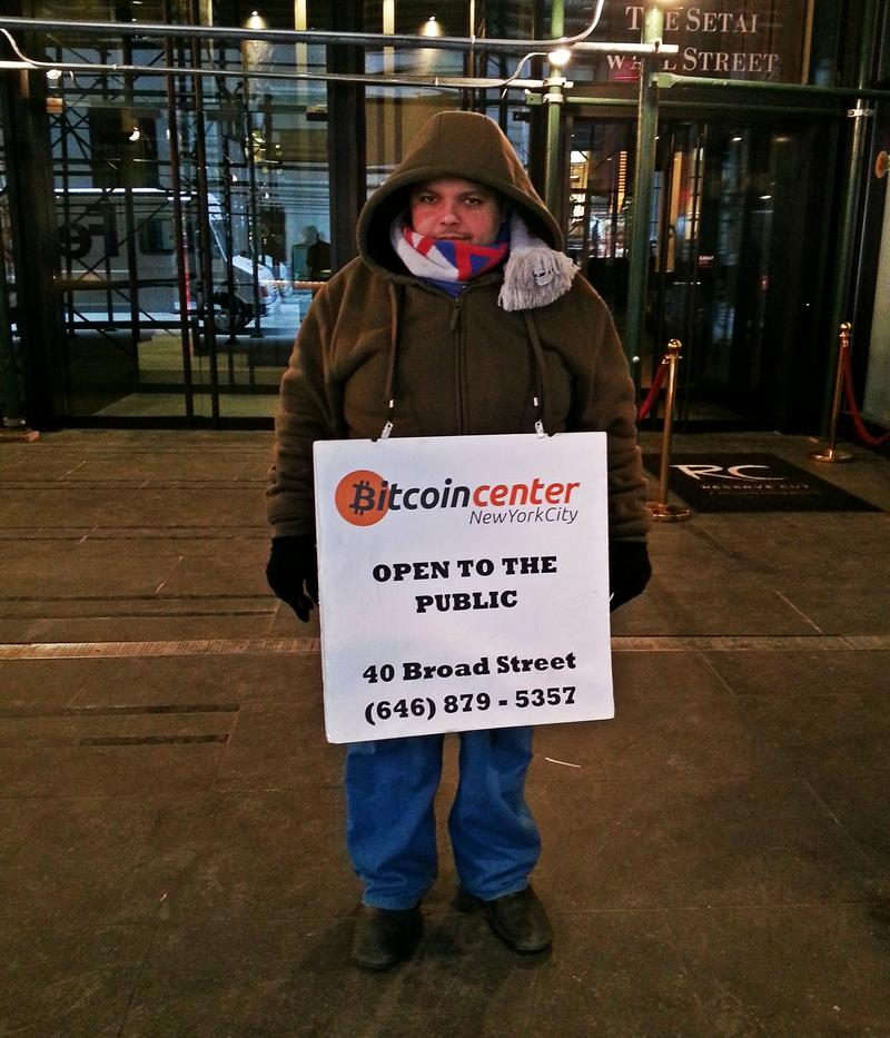 The Bitcoin Center's outreach includes sandwich board wearer Nizar Al Khalili