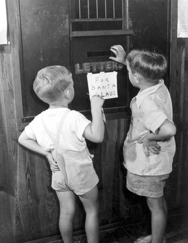 Mailing letters to Santa in the special letter box, 1947.