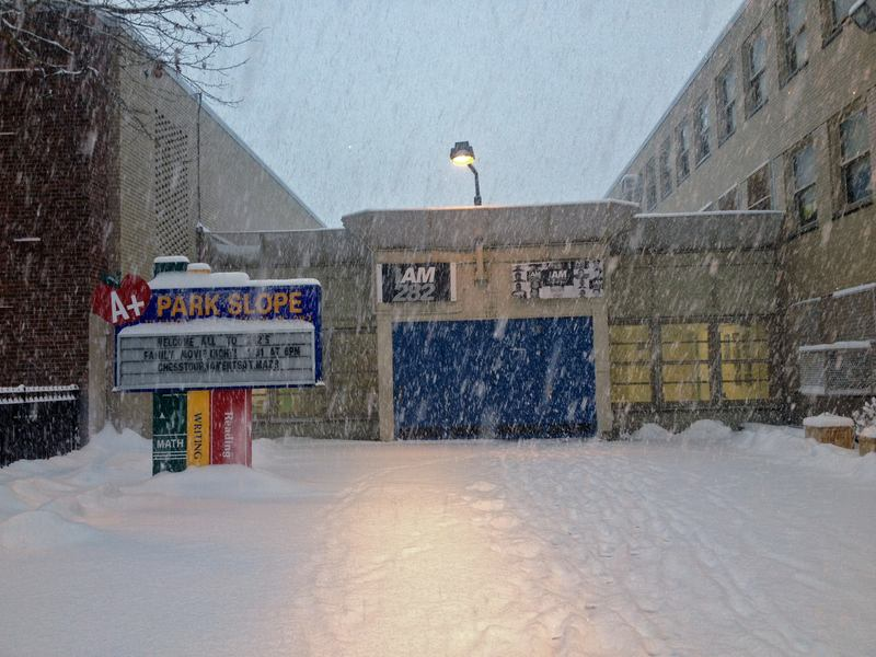 Despite the heavy snow, schools are open in New York City on February 13, 2014.