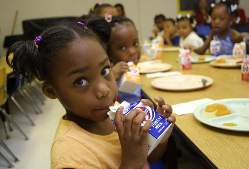 A student drinking milk at school.