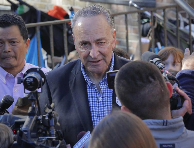 Senator Charles Schumer addresses the media after voting Tuesday in Park Slope, Brooklyn.