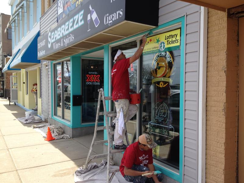 A crew paints storefronts in downtown Sea Bright in preparation for Memorial Day weekend