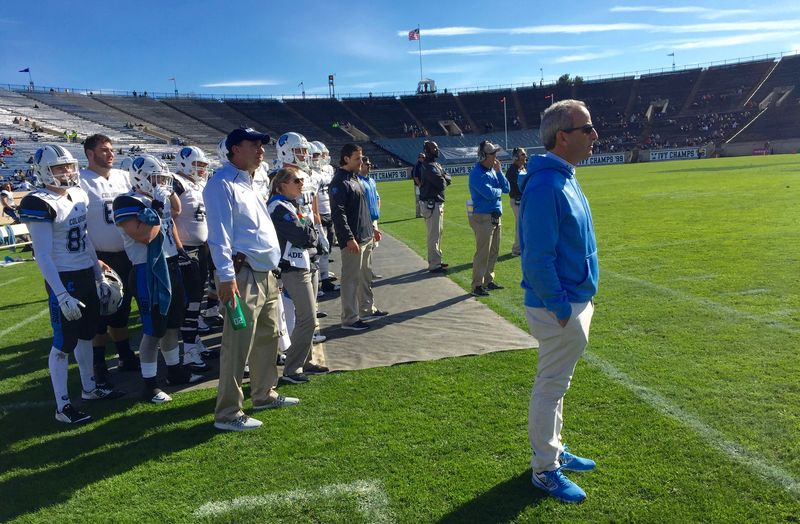 Athletic trainer Jim Gossett and team doctor William Levine man the sidelines for the Columbia Lions.