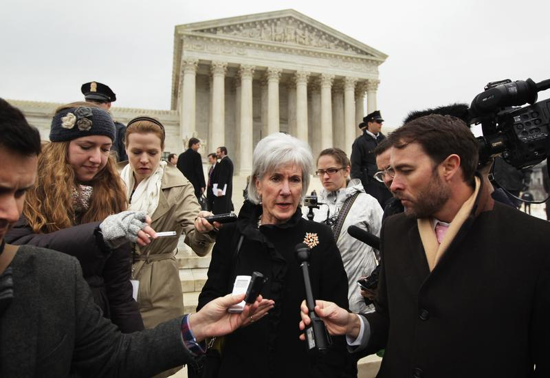 Former U.S. Secretary of Health and Human Services Kathleen Sebelius (C) speaks to members of the media as she comes out from the U.S. Supreme Court after oral arguments March 4, 2015 in Wash. D.C.