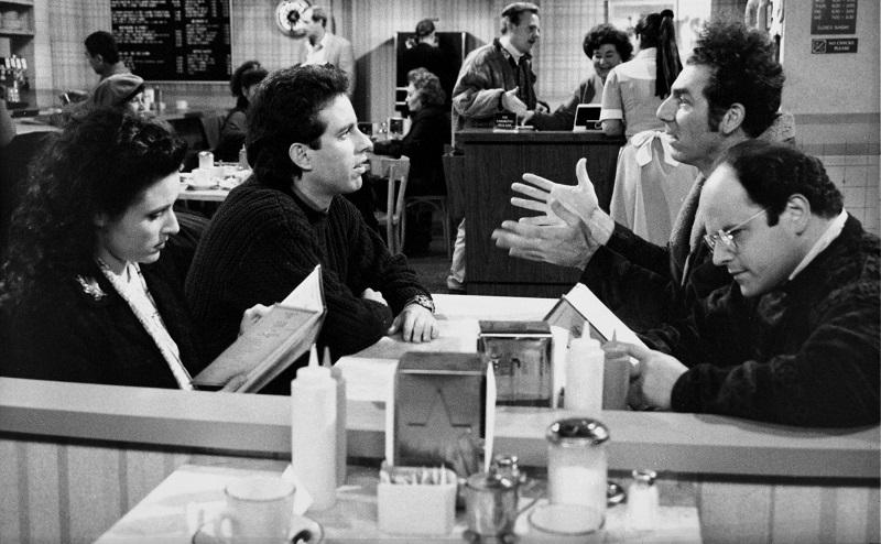 The Kiss Hello' Episode 17 -- Pictured: (l-r) Julia Louis-Dreyfus as Elaine Benes, Jerry Seinfeld as himself, Michael Richards as Cosmo Kramer, Jason Alexander as George Costanza