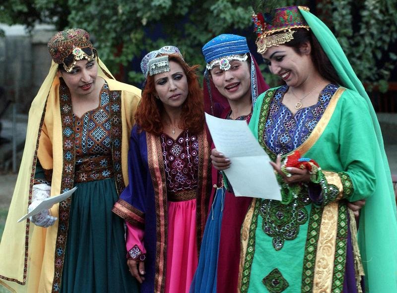 Afghan television star Sabar Sahar (R) reads out a letter as she plays a princess with the ladies-in-waiting in a rendition of Shakespeare's 'Love's Labour's Lost' in Kabul