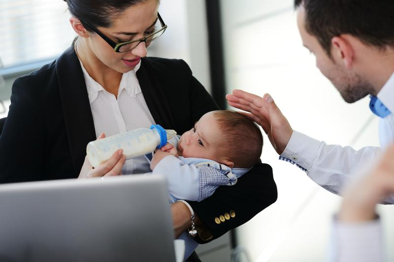 Business people taking care of a baby in the office