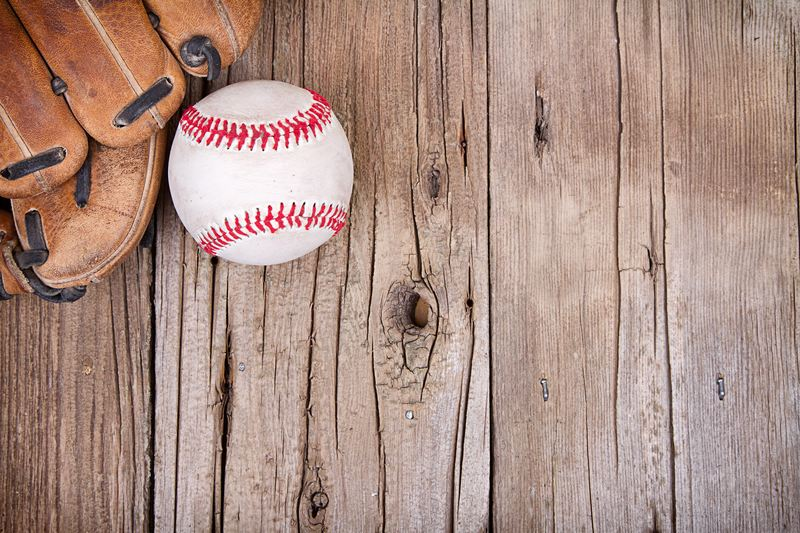 Baseball and mitt on a wooden background