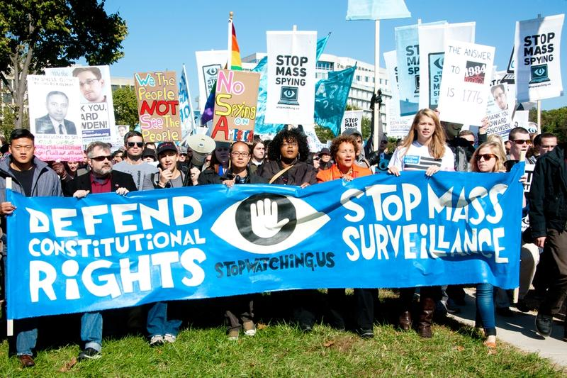Protesters rally against mass surveillance during an event organized by the group Stop Watching Us in Washington, DC on October 26, 2013.