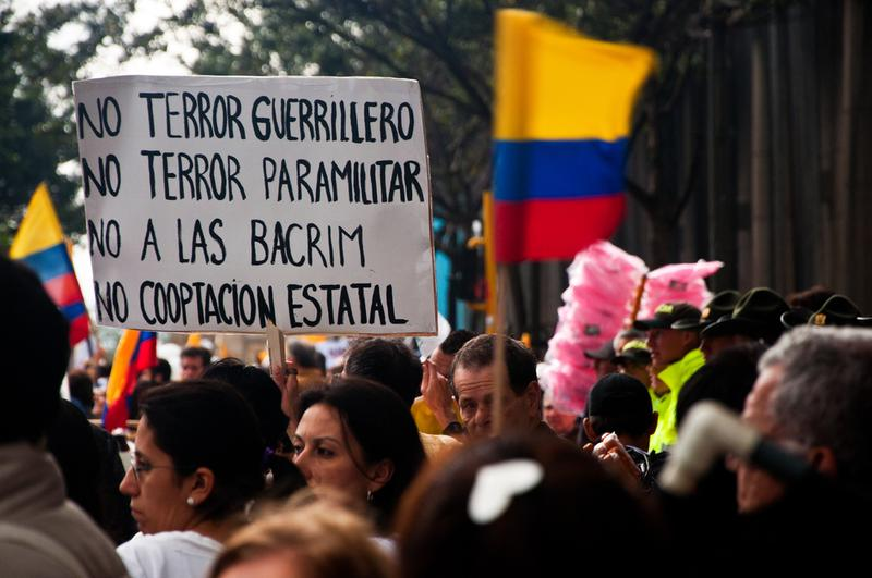 People line the streets of Bogota, Colombia to protest against the FARC on December 6, 2011.
