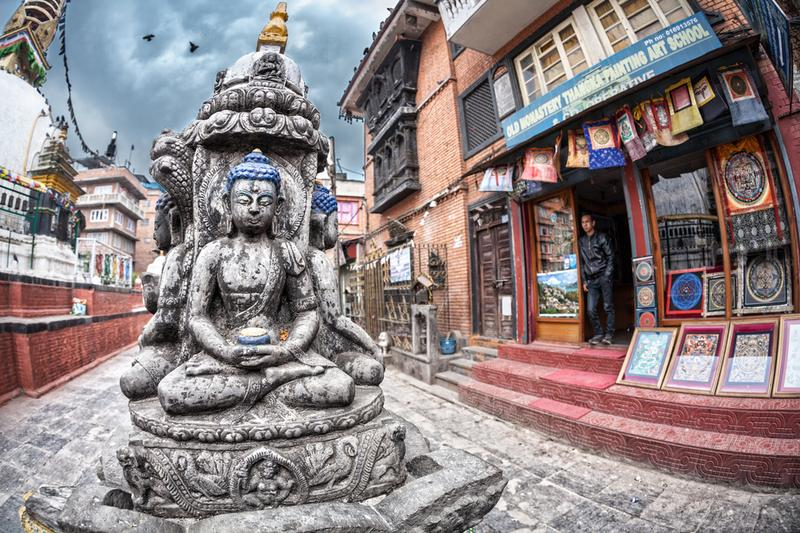 THAMEL, KATHMANDU, NEPAL - APRIL 3, 2014: A Buddha statue near tangka painting art school at Kathesimbhu stupa.