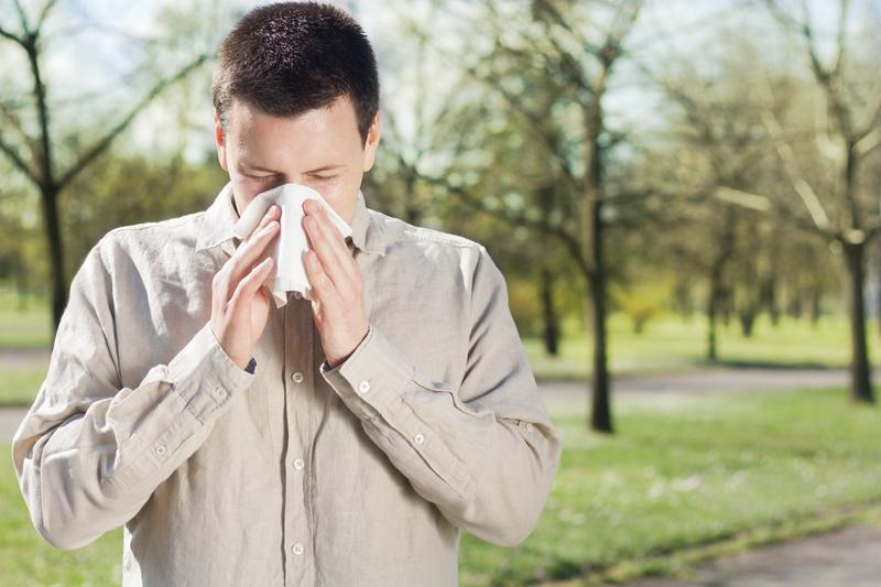 Allergies often cause sneezing.