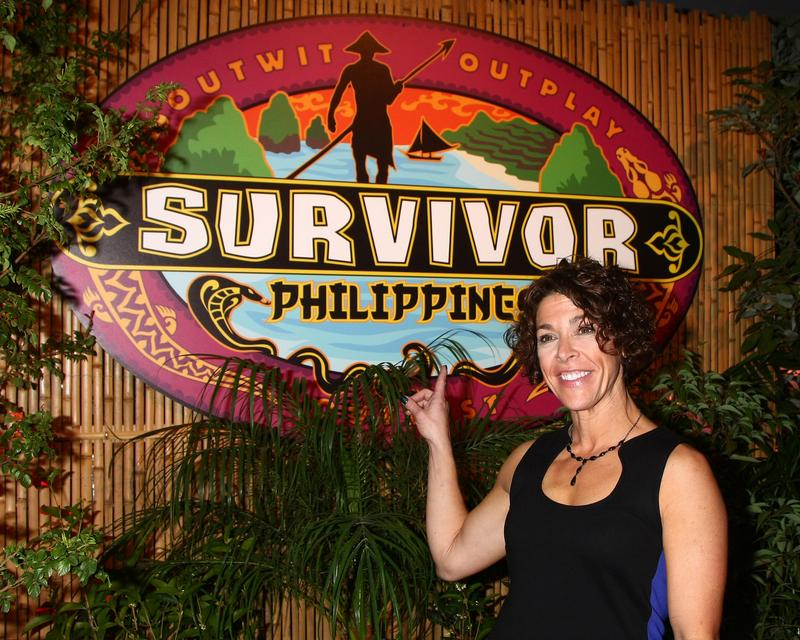 Denise Stapley posing for photos on the press line after winning 'Survivor: Philippines' reality show at CBS Television City on December 16, 2012, in Los Angeles, CA