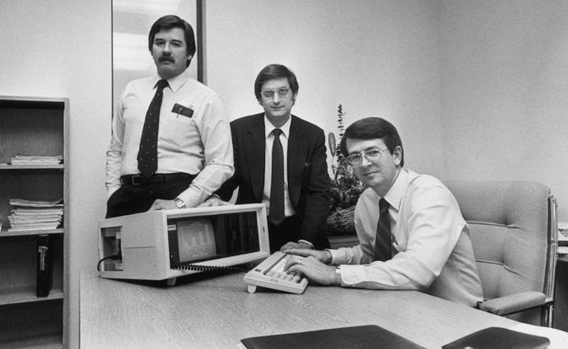 – Compaq Computer Co-founders (L-R: Jim Harris, Bill Murto, Rod Canion) with the first Compaq portable computer.