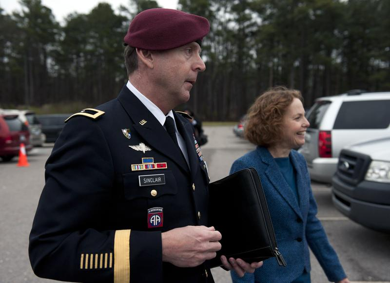 Brig. Gen. Jeffrey Sinclair (L) leaves the Fort Bragg Courthouse with his attorney Ellen Brotman.