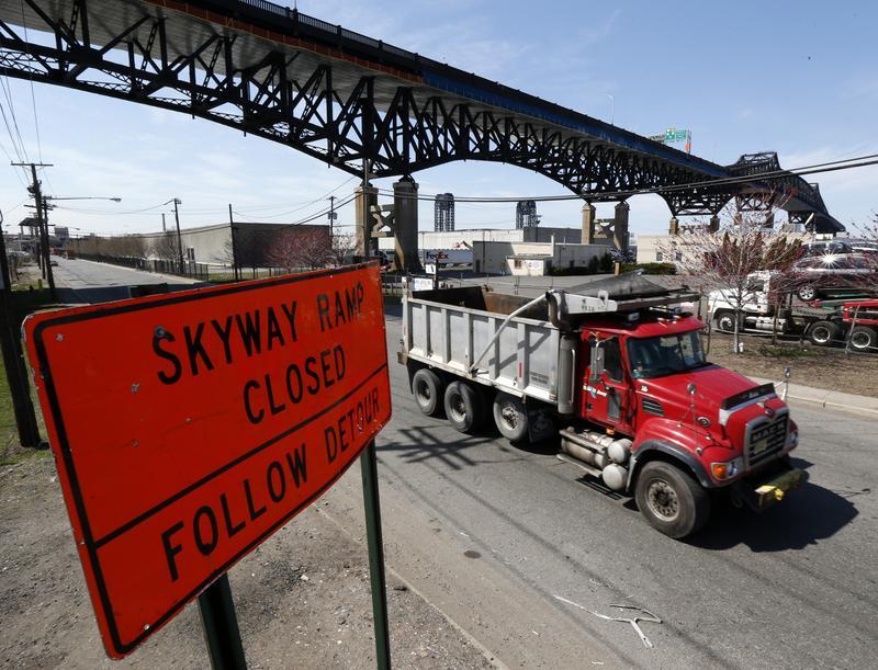A truck drives by a detour sign near the Pulaski Skyway, in Kearny, N.J., in 2014.