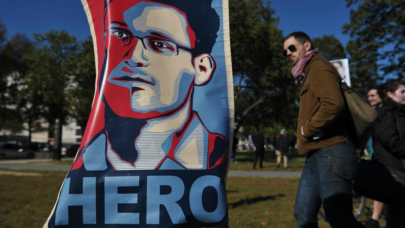 A portrait of Edward Snowden declaring him a 'hero' is seen during a protest against government surveillance on October 26, 2013 in Washington, DC.