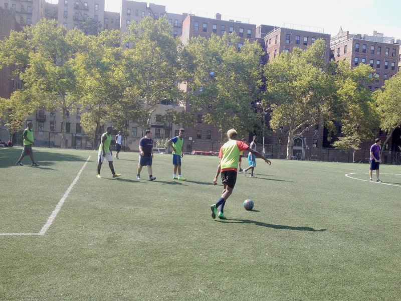 Unaccompanied children from Central America playing soccer at Mullaly Park in the South Bronx
