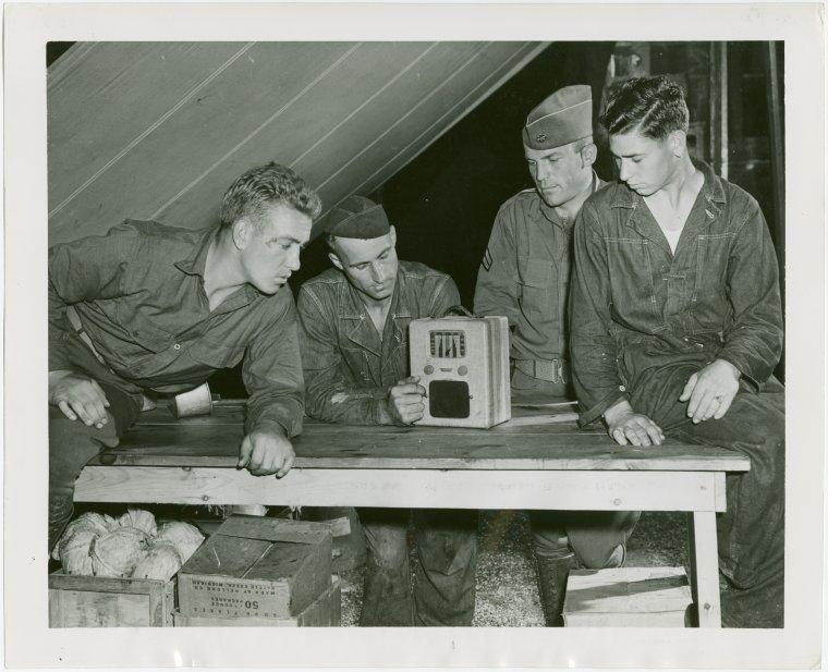 Soldiers listening to the radio.