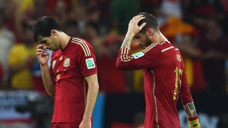 Javi Martinez (L) and Sergio Ramos of Spain look dejected in defeat after the 2014 FIFA World Cup match against Chile at Maracana on June 18, 2014 in Rio de Janeiro, Brazil.