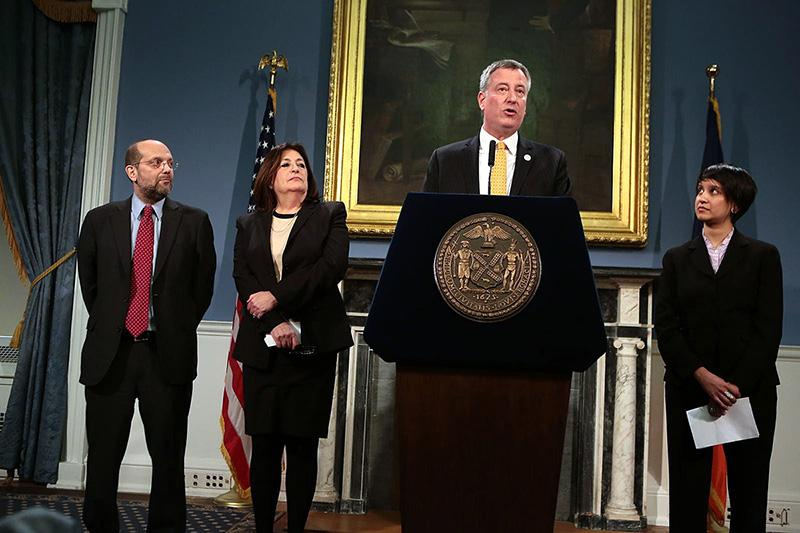 Mayor Bill de Blasio announcing the appointment of Steve Banks (left), Lorraine Grillo and Nisha Agarwal.
