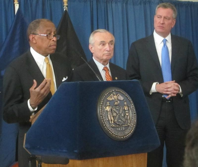 New York City's Corporation Council Zachary Carter, Police Commissioner Bill Bratton, and Mayor Bill de Blasio