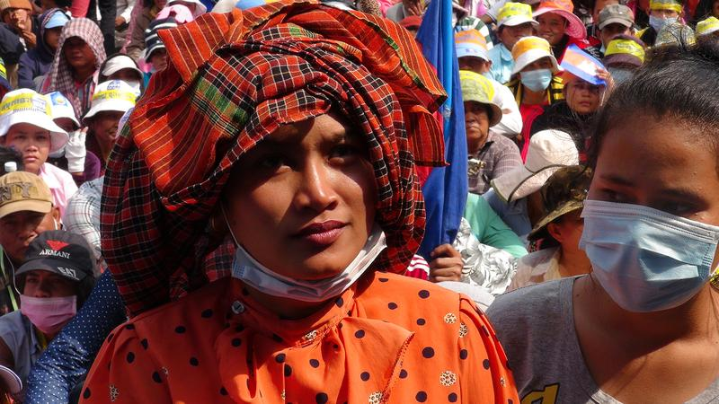 "A Cambodian woman attends a demonstration, as seen in the film ""Angkor Awakens: A Portrait of Cambodia."""