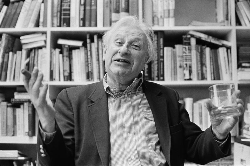 "Studs Terkel celebrating after winning the 1985 Pulitzer Prize for his novel, ""The Good War,"" inside his office at WFMT-FM Studio in Chicago."