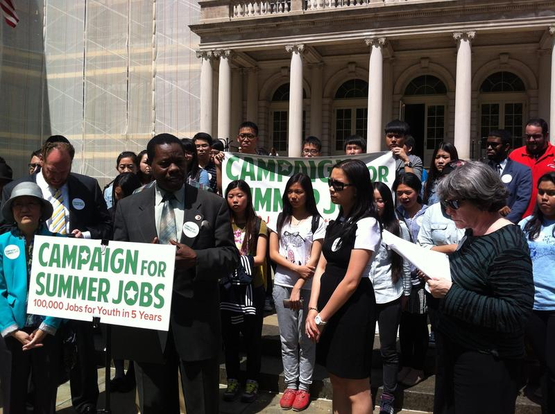 City Councilman Mathieu Eugene addresses a rally as part of the Campaign for Summer Jobs.