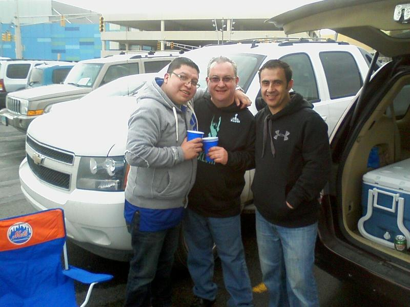 Dominick Arlistico, center, with two other dads in the Met Life Stadium parking lot during Super Bowl XLVIII.