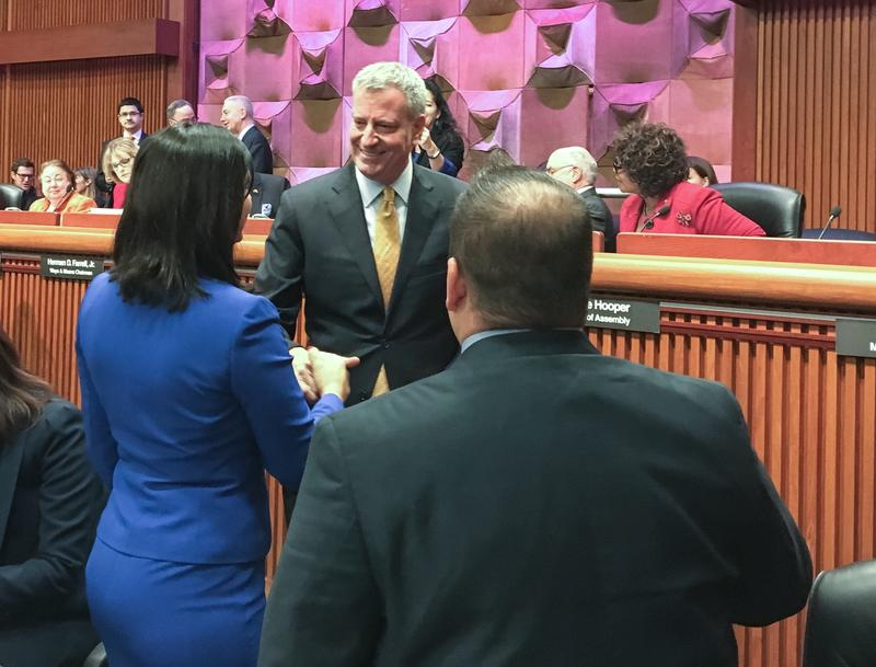 Mayor de Blasio greets Staten Island Assembly members Nicole Malliotakis and Ron Castorina before budget hearings.