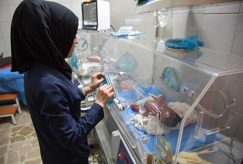 A Syrian nurse stands next to incubators with newborns who were evacuated by medical staff at a children's hospital to the basement following reported govt. bombardment within a few hundred meters