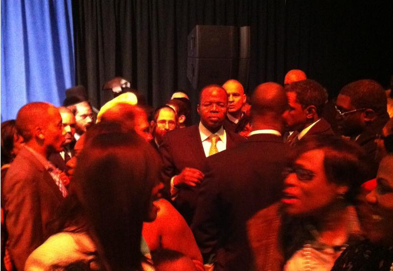 New Brooklyn District Attorney, Kenneth Thompson, swarmed by supporters after his lengthy, 800-person inaugural party ends.