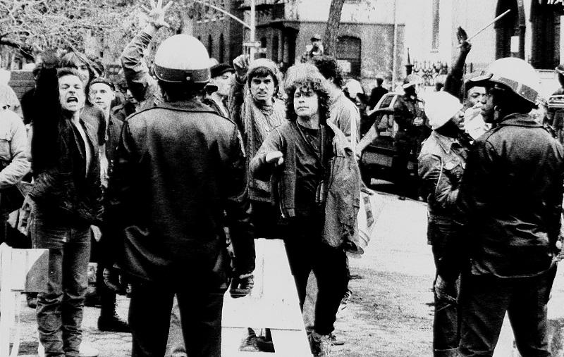 Protesters and police during demonstration at Tompkins Square Park, c. 1980s.