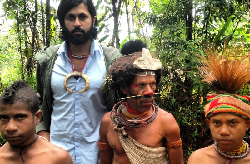 Vikram Gandhi with Munago, a local shaman, and his sons in Hela Province, Papau New Guinea.