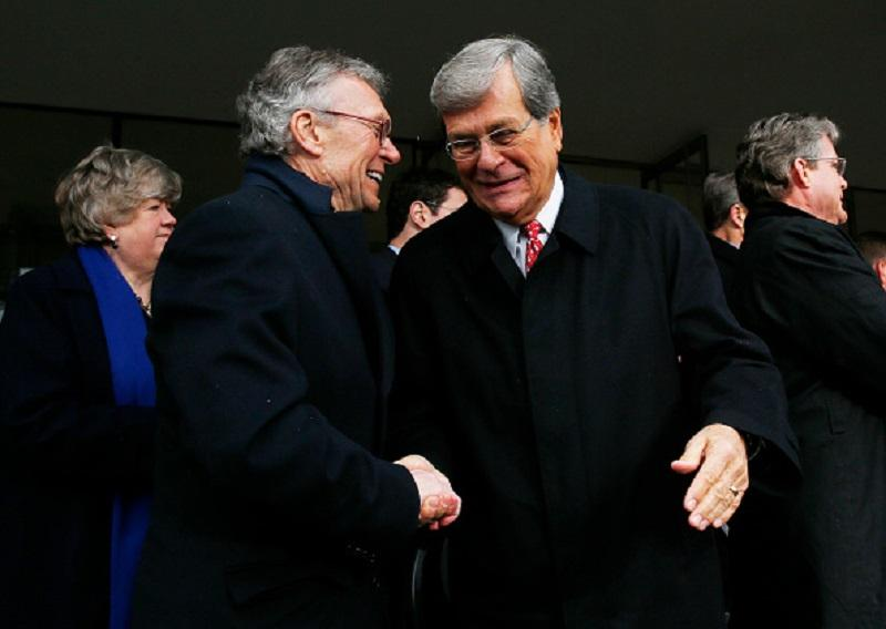 Former US Senator Tom Daschle, left, and former Senator Trent Lott, right, shake hands at the conclusion of a formal ceremony to dedicate the Edward M. Kennedy Institute for the U.S. Senate in Boston.