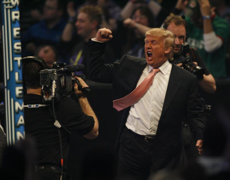 Donald Trump celebrates his Wrestlemania victory over Vince McMahon at the main event of the night, 'Hair vs. Hair', between Vince McMahon and Donald Trump.