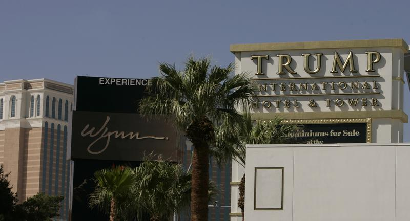 The sign from Steve Wynn's megaresort is framed by Sheldon Adelson's successful Venetian Hotel, left, and a sign advertising Donald Trump's future hotel-condo towers, right, Monday, June 6, 2005 looki