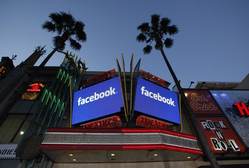 Screens outside the Grauman's Chinese Theatre on Hollywood Blvd. advertise Facebook's IPO.