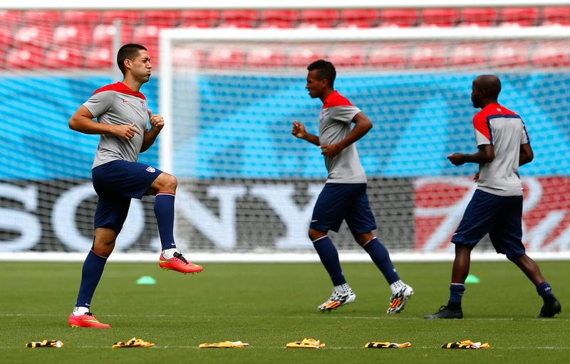 Clint Dempsey of the United States stretches during training at Arena Pernambuco on June 25, 2014 in Recife, Brazil.