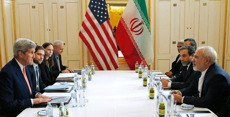 US Secretary of State John Kerry (L) meets with Iranian Foreign Minister Javad Zarif (R) in Vienna, Austria on January 16, 2016.