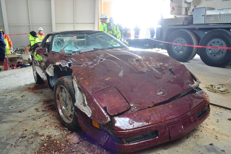 A 1993 Corvette aftering being retrieved from a sinkhole in Lexington, KY