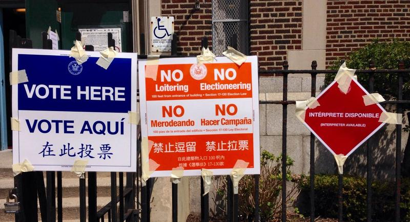 "Multilingual ""Vote here"" signs outside of a polling site in Dyker Heights, Brooklyn."